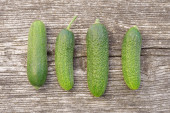 Cucumbers on wooden background — Stock Photo