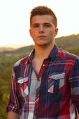 Handsome young man portrait outdoor — Stockfoto