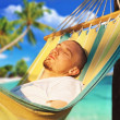 Young man relaxing hanging chair — Stock Photo #76557747