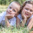 Little boy and the girl lie together on a grass — Stock Photo #66340711