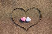 Heart drawn in the sand with two hearts — Stock Photo