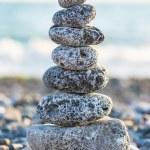 Cairn on the pebbly sea beach — Stock Photo #66651633