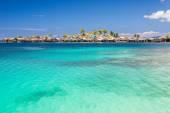 Sea gypsies village on blue lagoon — Stock Photo