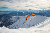 Paraglider launching from snowy slope — Stock Photo