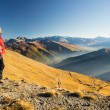 Hiker resting on the mountain top — Stock Photo #65809027