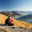 Hiker resting on the mountain top — Stock Photo #65809369