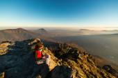 Woman resting on the mountain top — Стоковое фото