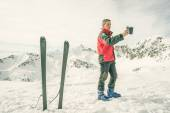 Alpinist taking selfie with smartphone — Stock Photo