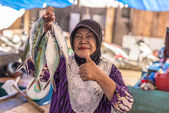 Woman selling fishes in local market — Stock Photo