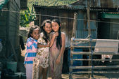 Smiling cute young girls in slum, Indonesia — Stock Photo