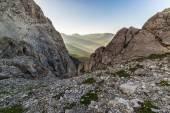 Last sunbeams on alpine valley — Stock Photo