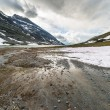Melting snow at high altitude in the Alps — Stok fotoğraf #75946751