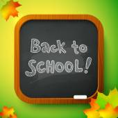 Chalk Back to School sign on black school board — Stock Vector