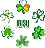 Green Irish clovers in logo style — Stock Vector