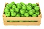 Green apples in the wooden crate — Stock Photo