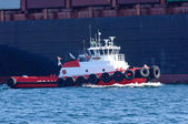 Harbor Tugboat with Cargo Ship — Stock Photo