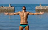Handsome muscular man on the beach. — Stock Photo