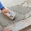 Tiler works with flooring. — Stock Photo #53682081