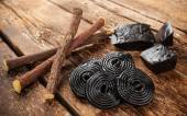 Production steps of licorice, roots, pure blocks and candy. — Foto de Stock