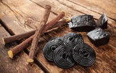 Production steps of licorice, roots, pure blocks and candy. — Foto Stock