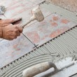 Tiler to work with tile flooring. — Stock Photo #54999827