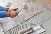 Tiler to work with tile flooring. — Stock Photo