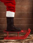 Red sled with the boot of Santa Claus — Foto Stock