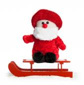 Wooden red sled with Santa Claus plush — Stock Photo
