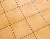Brown ceramic floor tiles — Stock Photo