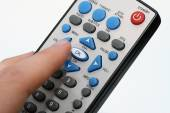 Dirty remote control in hand — Stock Photo