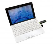 Netbook with internet key — Stock Photo