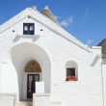 Sovereign trullo in Alberobello — Stock Photo #57998665