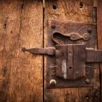 Old lock of a wooden door's Trullo in Alberobello. — Stock Photo #58032823