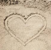 Heart drawn in the sand. — Stock Photo