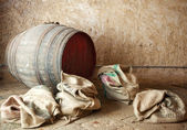 Old barrel with burlap sacks. — Stock Photo
