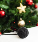 Black microphone with christmas tree — Stock Photo