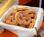 Basket of fried pretzel with sugar. — Stock Photo