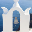 White bell tower at Oia, Santorini, Greece. — Stock Photo #62512737