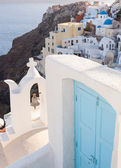 View of the village Oia with blue door. — Stock Photo