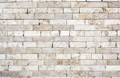 Wall made with bricks of marble. — Stock Photo