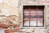Old window with iron gratings — Foto Stock