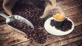 Espresso coffee in glass cup with coffee beans. — 图库照片