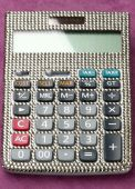 Calculator covered with swarovski crystals — Stock Photo