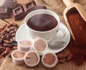 Cup of hot chocolate with pods. — Stock Photo