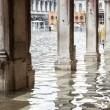 View of the arcades with high water in Venice. — Stock Photo #64332177
