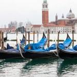 Venetian gondolas with high tide. — Stock Photo #64332415