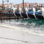 Venetian gondolas with high tide. — Stock Photo #64332485
