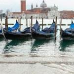 Venetian gondolas with high tide. — Stock Photo #64332569