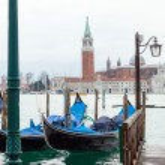 Venetian gondolas with high tide. — Stock Photo #64332631