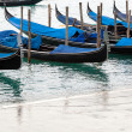 Venetian gondolas with high tide. — Stock Photo #64332831